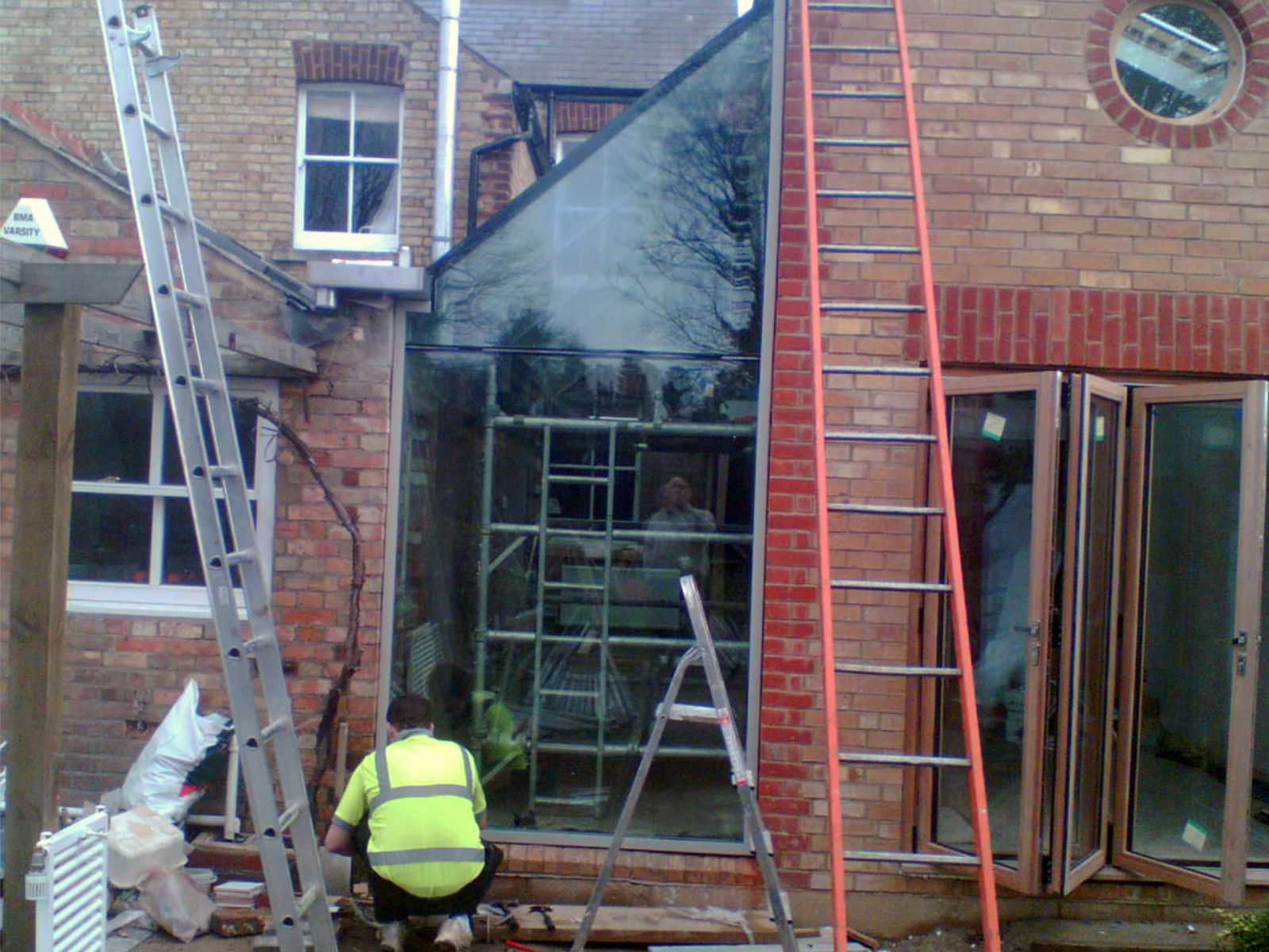 Install residential structural glass.